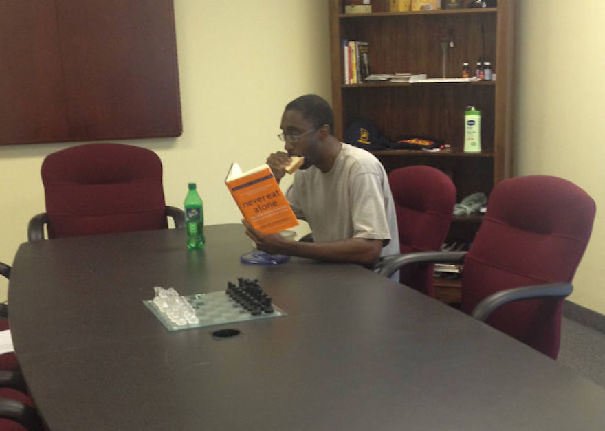 17 Hilarious Pictures Of People Reading All The Wrong Books In Public - Clearly, This Is One Of The Last Times This Guy Plans To Eat Alone