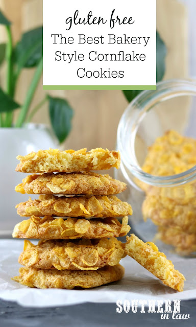 Classic Gluten Free Cornflake Cookies Recipe - Classic cornflake cookies in a stack in front of glass cookie jar in white kitchen