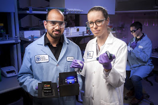 Sandia National Laboratories researchers Aashish Priye  and Sara Bird offers a view into the Zika box prototype. Credit: Randy Wong