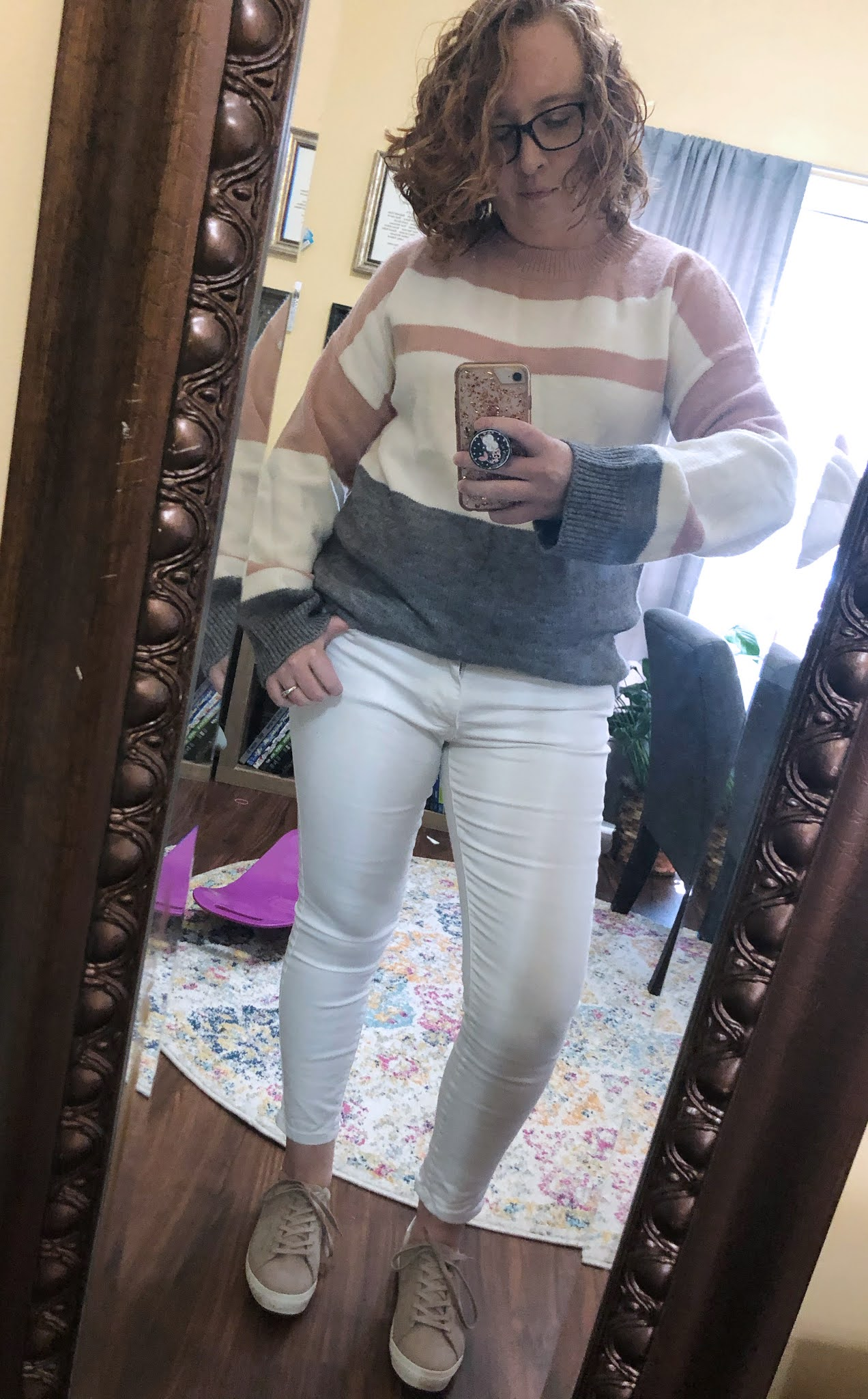 white jeans gray and pink striped sweater