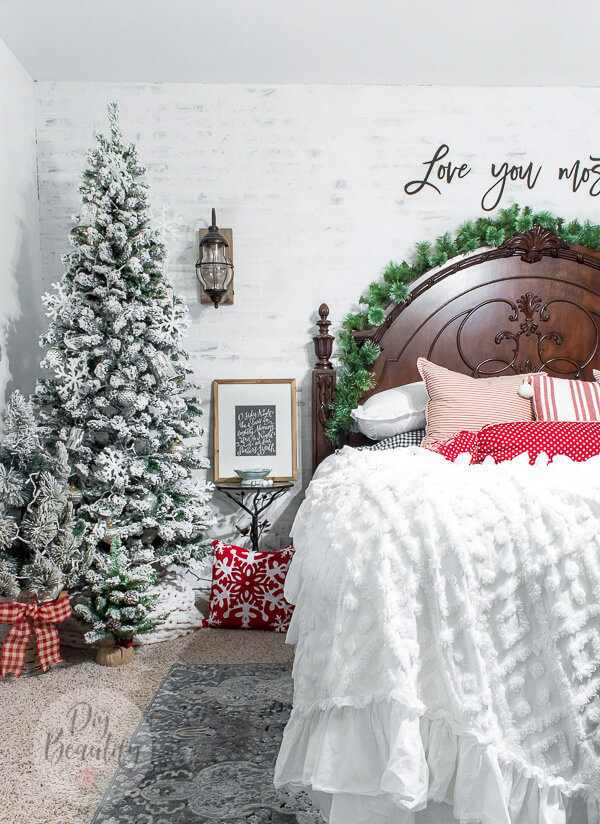 Christmas bedroom with flocked trees and red and white