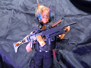 Barbie holding guns - image by ArielleJay via Morguefile.com