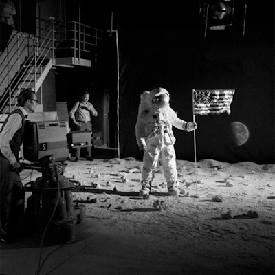 A hoax or simulation of the Moon landing with the US flag.