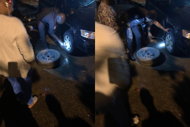 [PHOTOS] Police Officers on Patrol stumbled on a Lady in distress and helped her fix her flat tyre
