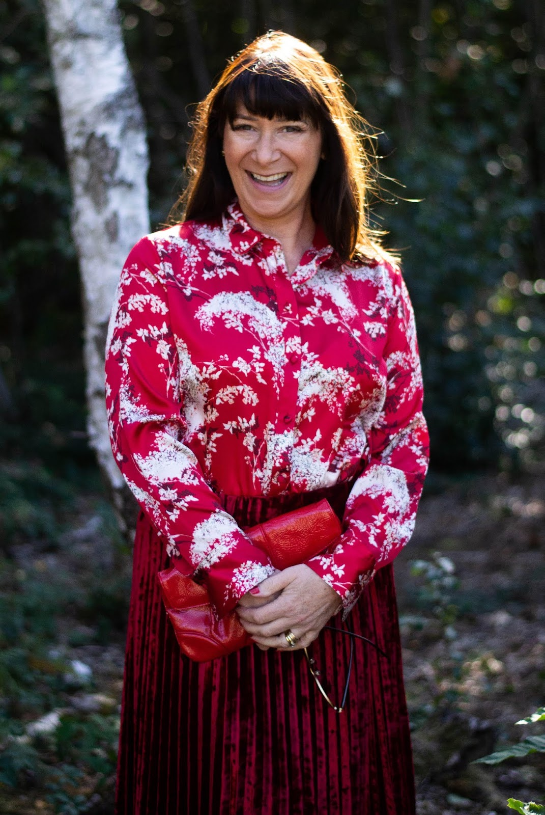 Showing one look with a red and white blouse, Jacqui Berry from fashion blog Mummabstylish