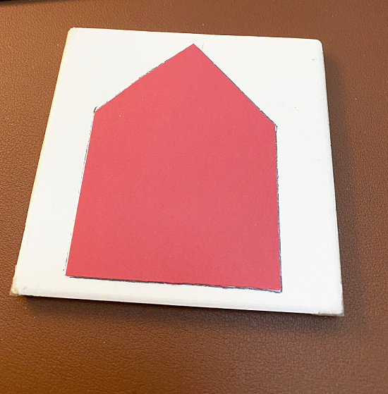 red card stock house shape traced on to tile