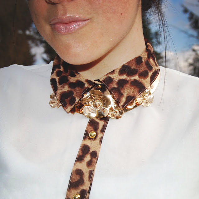 Gold collar and a leopard detailed blouse