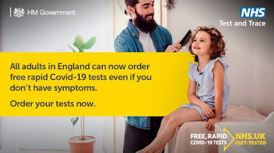 All adults in England can order COVID Lateral flow tests. Beardy man grinning while combing young girl's hair