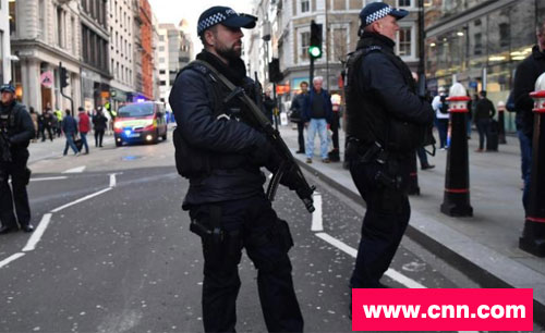 Armed police near Borough Market.  Photo courtesy CNN.COM