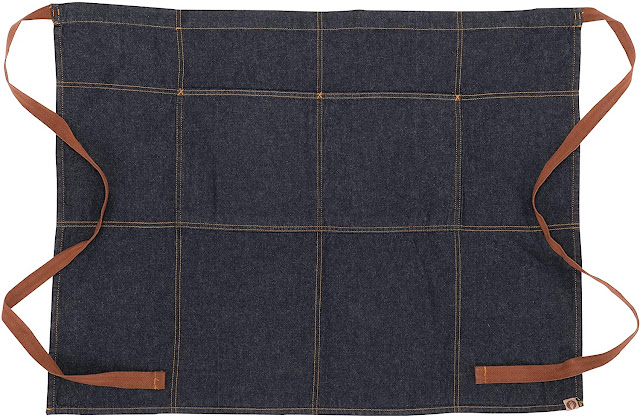 Here's an apron, reminiscent of the one Julia Child wore. Denim, with pockets for kitchen tools and an all-important tie for tucking your towl into.