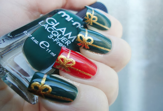 Christmas packages with ribbon nail art