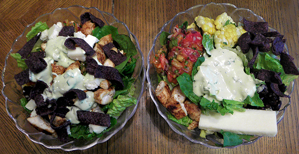 Two different salads made by two different individuals