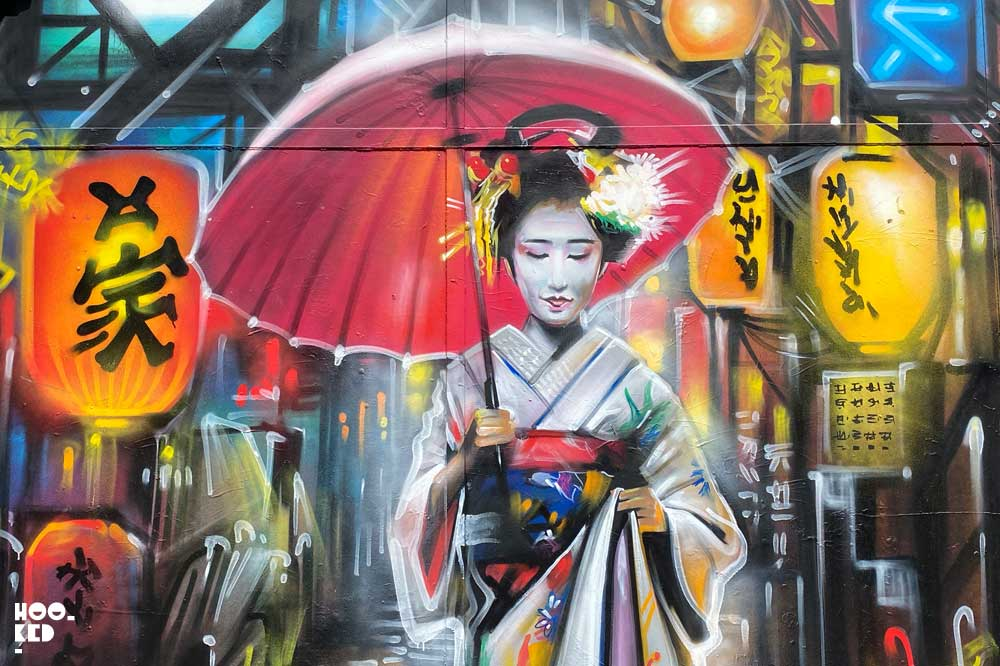 Close up detail of Dan Kitcheners Beautiful Geisha Street Art on Commercial Street, London