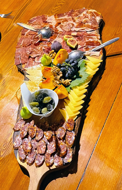 Meats, cheeses, olives and figs on a platter