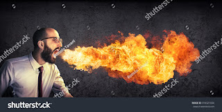 angry-and-furious-announcement-businessman-spitting-fire-310321334