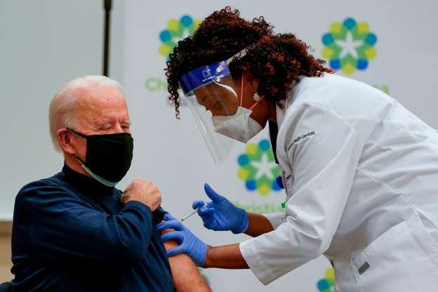 Biden receives Covid vaccine on live TV in effort to inoculate America