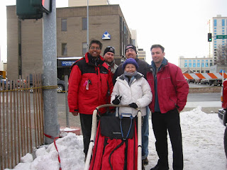 David Brodosi and family checking out the Iditarod race events in Alaska with sled