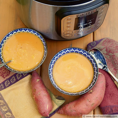 pic of 2 bowls of curried sweet potato soup and an Instant Pot on a table with napkins and sweet potatoes