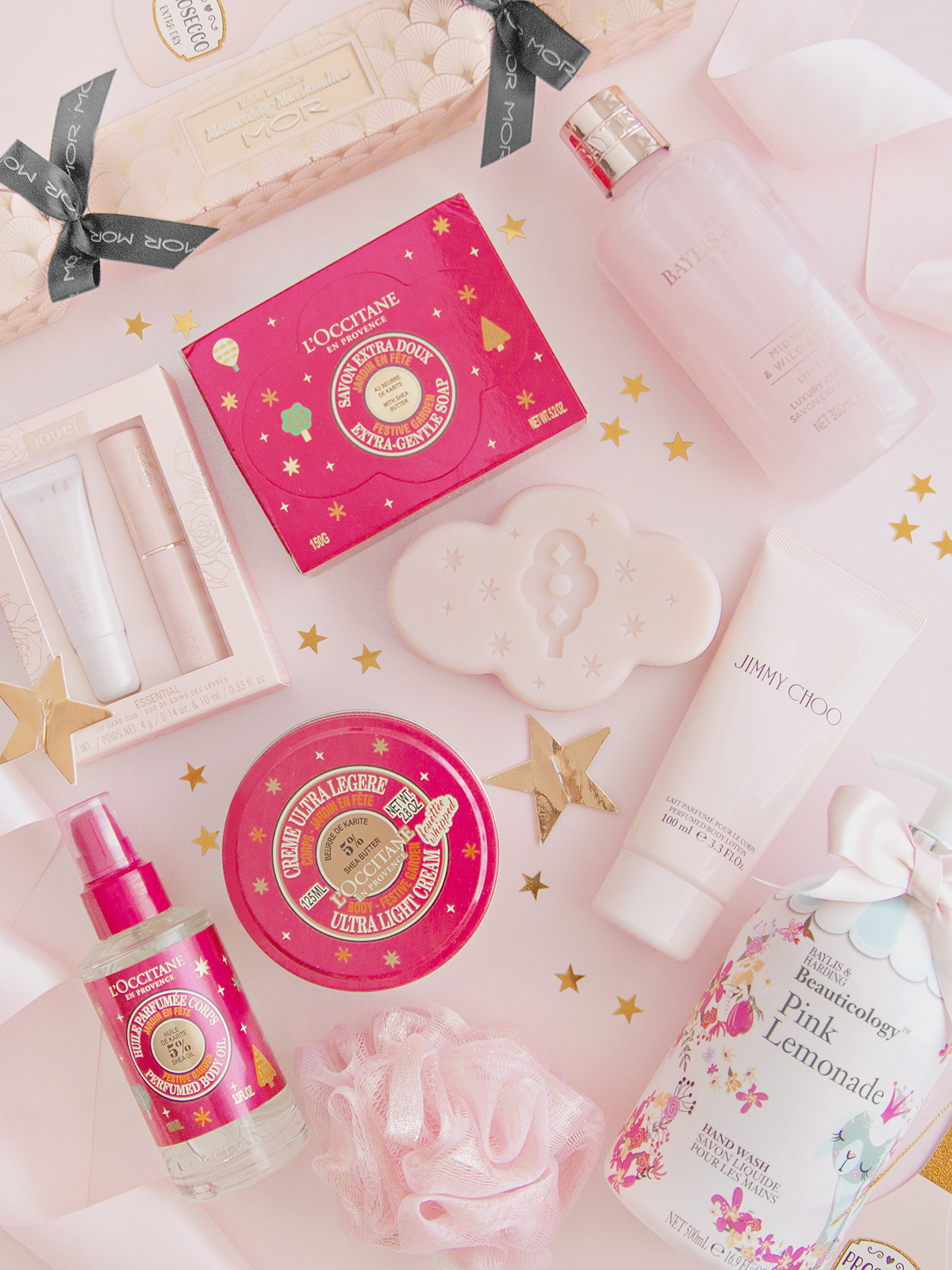 A selection of Bath and Dody Christmas products from brands L'Occitane, Baylis and Harding and Jimmy Choo