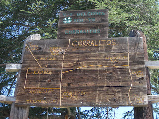 Rustic wooden signs, 4-H Welcomes You to Corralitos / Area Map