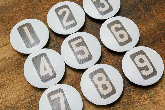 Dollar Tree magnets get a farmhouse update with vintage inspired numbers.
