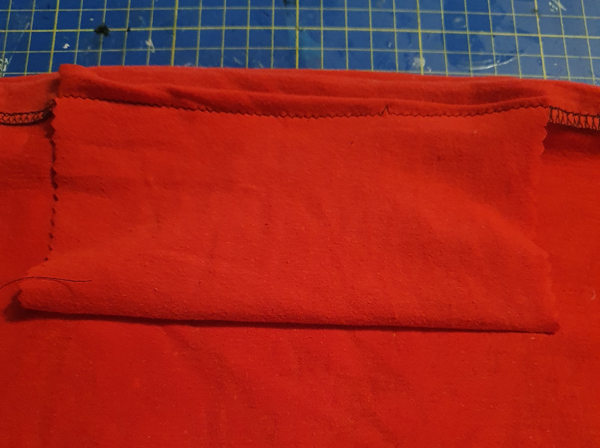 Inside pocket for a snood, made so a filter can be added and used as a face covering