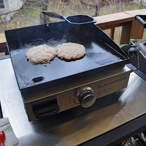 """Cooking chicken smash burgers on the Blackstone 17"""" griddle."""