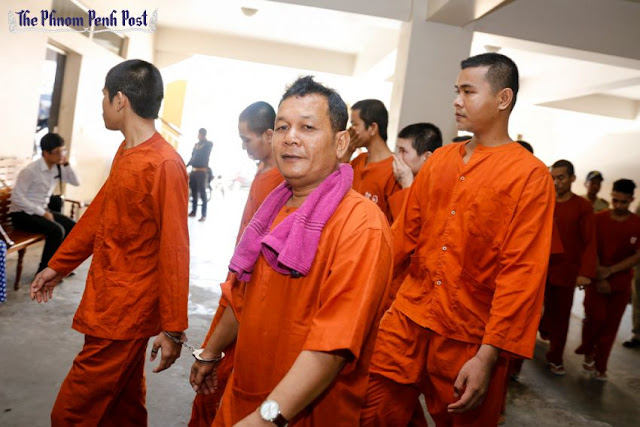 Sot Vanny (centre) arrives at Phnom Penh Municipal Court earlier this month for questioning about his involvement in an attack on opposition lawmakers in October. Pha Lina