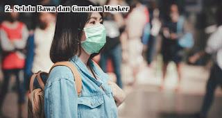 Selalu Bawa dan Gunakan Masker merupakan tips aman traveling di tengah pandemi