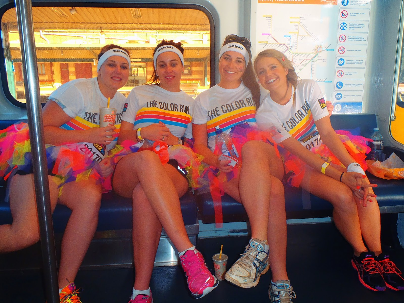 4 of us on the train in our bright tutus