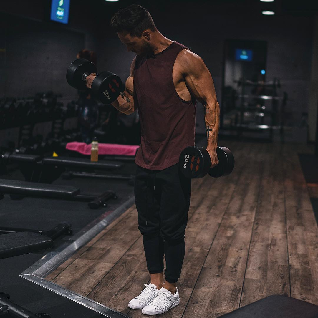 handsome-man-gym-working-out-veiny-arms-slim-hipster-lifting-weights