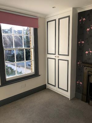 window and floor-to-ceiling cupboard