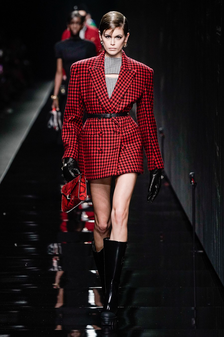 Kaia Gerber layered up in plaid pieces on the Versace Milan Fashion Week FW20 Runway