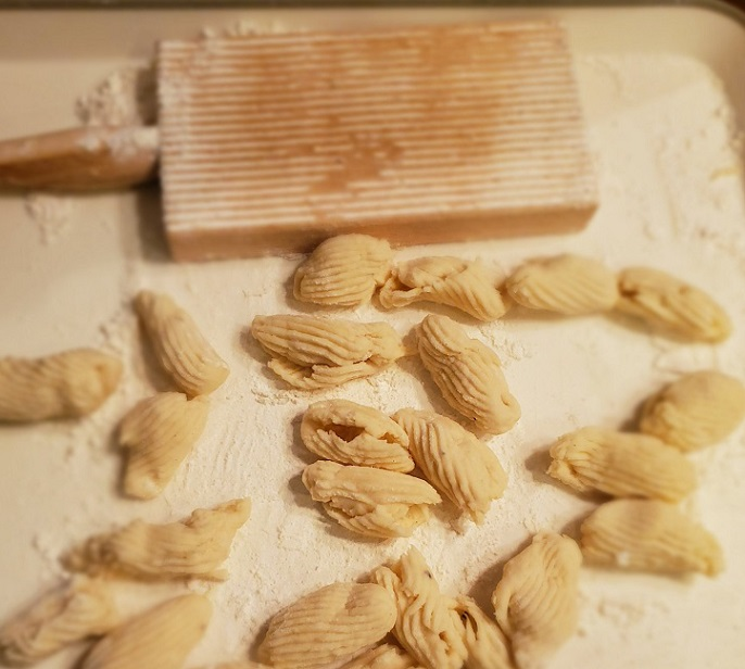 this is homemade cavatelli using an gnocchi board