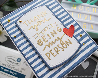"Handstamped card with a navy striped background, and gold heat embossed sentiment reading ""Thank you for being my person"".  Thank You for Being Stamp set, and Label Dies, by Concord & 9th."