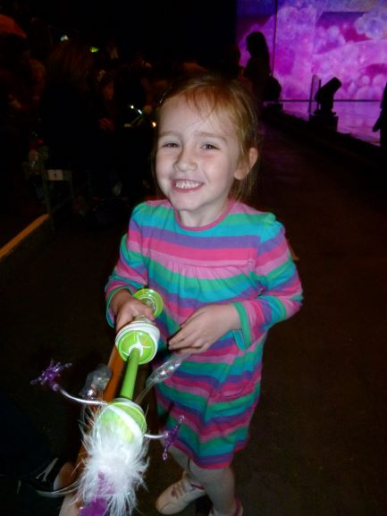 sasha with light up toy and big grin