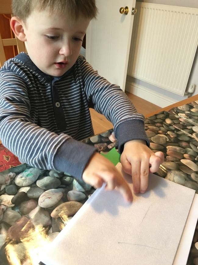 toddler-pressing-sheet-of-polystyrene