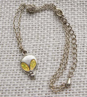 Yellow glitter alien head pendant necklace