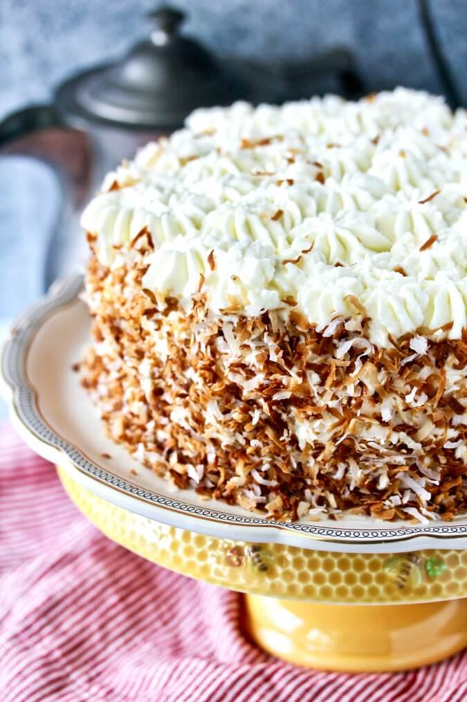 Italian Coconut Crème Cake with toasted coconut