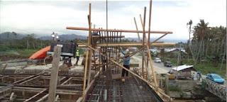 Pemasangan overstek besi balok pelengkung