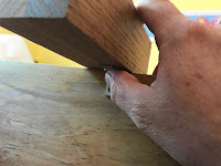 Using a block of wood to make the corner brace flush against the edge