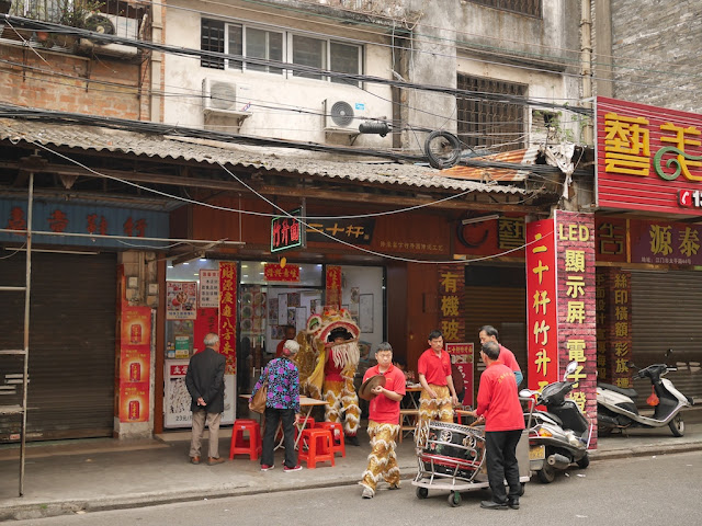 Lion dance troupe at a noodle restaurant in Jiangmen