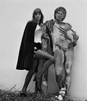 Jane Birkin in a cape with a statue
