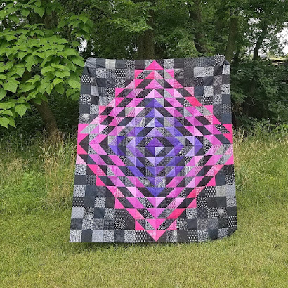 Scrappy version of the Water Drop quilt pieced by Maeberry Square.