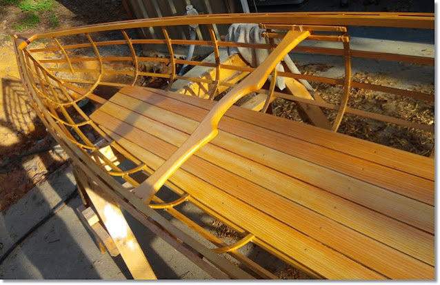 The wooden frame of a canoe