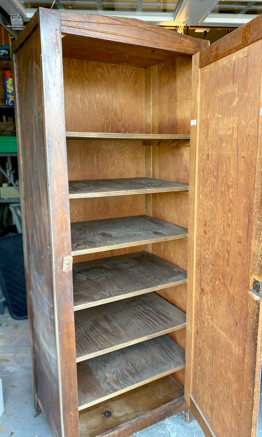 Large unfinished cupboard with open door