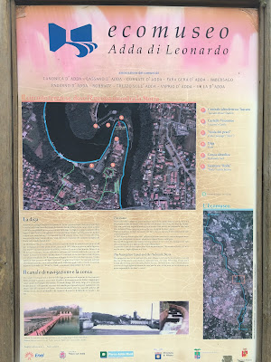 A sign explaining the open-air museum along the Adda River: Ecomuseo Adda di Leonardo.