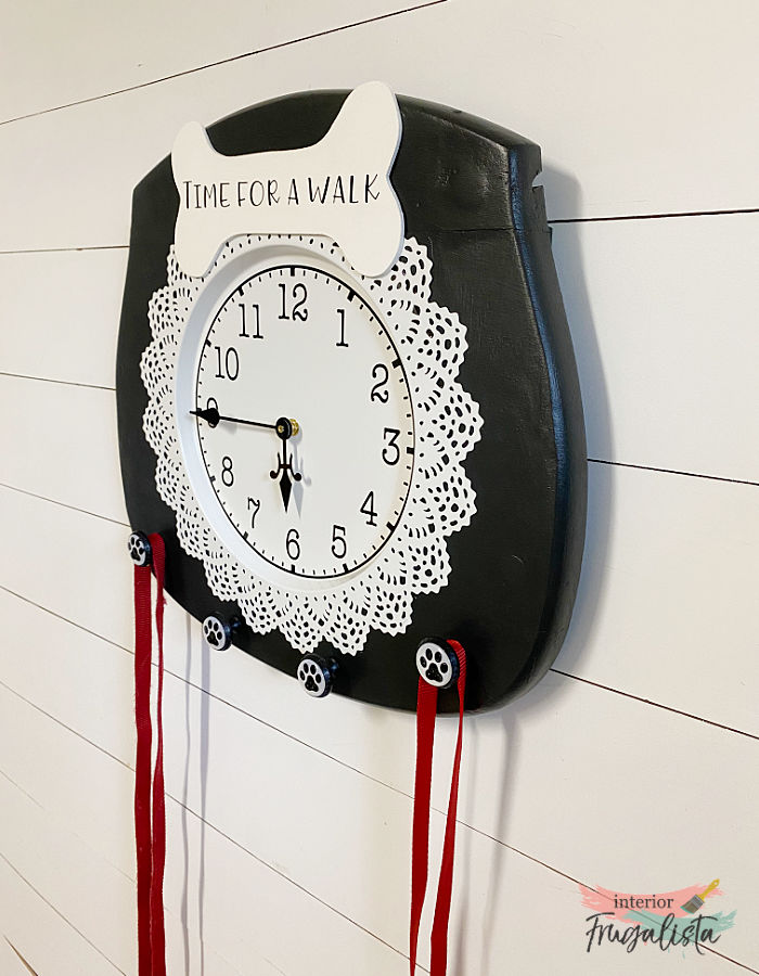 How to turn an old cane chair seat into a one-of-a-kind dog leash holder with a Time For A Walk Clock and paw print dog leash hooks for the back door.