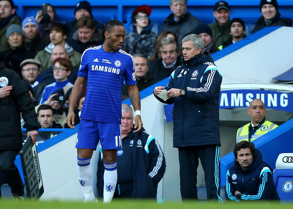 José Mourinho the manager of Chelsea sends on Didier Drogba of Chelsea as a second half substitiute during the Barclays Premier League match between Chelsea and Burnley at Stamford Bridge on February 21, 2015 in London, England