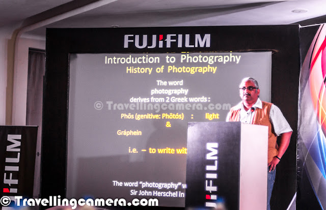 On 16th of October Fujifilm orgaized their first Blogger meet at Park Hotel in Delhi. Event was specially designed for some of the premier bloggers in the city and had a launch ceremony during the end. Let's check out this Photo Journey to know more about the meet..I took half day leave from office and reached Park Hotel at 2:50pm. Event had to start at 3:00pm. I was the first blogger to reach the venue and stand-up comedian Rajneesh Kappor was there. i had attended one of him performance at India Habitat Center, Lodhi Estate(Delhi). Talked to him and he was more interested in knowing the kind of people coming for the evening.  Planned start time 3:00pm in Delhi means that starting will not happen before 3:30pm and there can be delay of 1 Hr. So I had enough time to see Fujifilm Digital Cameras which they had placed on some of the counters around conference hall. Whole hall was full of round tables placed beautifully. Checked some of the Fujifilm Mirrorless cameras and SLRs. I was surprised to see DSLRs Fujifilm had. They had no option to change lenses. All of them had fixed lenses with amazing zoom of about 600mm. At one place I found it bad but looking at mass market, probably this is one of the good approach for home use or amateur photographers.More bloggers started joining on first floor of Park Hotel. Arvind Khanna is trying Mirrorless cameras at Fujifilm Blogger Meet. Fujifilm had great range of mirror-less cameras and I personally liked the results. They created a shooting area with some objects lying under good light. In Poiint-n-shoot, Fujifilm has good range. Anyways, it was time to move ahead and proceed with other parts of event.Bloggers started joining in and it was one of the great moments when you meet fellow who you follow online. Thanks to all such events and we bloggers keep meeting to discuss new ideas & news in detail. While catching up with Bloggers, I noticed one of the familiar faces sitting there. He is there on my Facebook account. After putting some pressure on my mind, I could recall his name and other relevant details :) . Hemant Sood, who is a photographer and popularly known for his fashion work. I had a quick chat with him and it was a nice interaction. He was there to share Fujifilm Camera reviews with bloggers.After a brief chit-chat with fellow blogger over a cup of coffee there was a call for everyone to be seated and start the evening. Fujifilm Marketing folks welcomed all bloggers and shared some interesting facts about Fujifilm and technologies they share with customers or other businesses. During his talks he shared about X series cameras, what is so special about those and Fujinano lenses. Then some bollywood movie-examples were shared which were shot with Fujifilm Lenses. Movies like Dabang & Slumdog Millionaire etc. As the event started, there was an announcement for every blogger to start tweeting about the event & Fujifilm with hash-tag #fujifilmxisin and one of the blogger would win a Fujifilm Camera. Initially I has hesitant about it as I always avoid to use Twitter. I have linked my Twitter account to pick automatic updates from the blog and that's it. After looking around for 5 minutes, I also thought to give it a try. At the time, there was another announcement about being attentive to the details makreting folks were sharing. A quiz was planned after the talk and winners got T-Shirts. I also managed to get one :). Some of the other bloggers on my table got multiple and ours table was winner of-course :) Sangeeta, Arvind and Kriti rocked the show !After a quick quiz Mr Rajneesh Kappor came to the stage. He is a popular standup comedian in Delhi and goes to various parts of country for big comedy shows. He was really good, although I felt that people sitting there were not that supportive :) ... I loved the way he make fun of day to day things and he is awesome with Delhi Jokes :)Most of the bloggers were carrying cameras but I didn't see any Fujifilm camera with any of them. Most of the bloggers were having Nikon or Canon DSLRs. DSLRs and Phone-Cameras are most popular these days. And slowly it's becoming hard to see point-n-shoot cameras. During one of the talks Fujifilm folks also mentioned about the same that Point-n-Shoot market is facing good competition from Smart-Phone CamerasEnvironment all around the conference hall was quite friendly by the end of Rajneesh's session. It was really great and some of the marketing folks in the back were quite involved in whole comedy session. Their laugh was completely different from rest of the halSoon after Rajneesh's performance, Hemant Sood joined us on stage. He shared some great thoughts around Photography and basic tips for bloggers. I must say that he was quite honest about some of the basic facts about photography. I found him quite open about the role of importance of Equipments in Photography. He talked in detail about basic functions of Camera and then kept things open for bloggers to focus more on visuals rather than rules we see on web or books.During the end some celebrity was expected to join and announce the winner of Twitter contest. She came to the stage and it was extremely difficult for me to recognize her. When Fujifilm folks introduced her, then we got to know that she is Minisha LambaAs expected she talked about Fujifilm cameras and winner was declared. @Photojourney_TC was the winner and this is our handle on twitter. Thanks Fujifilm for inviting and liking our tweets.